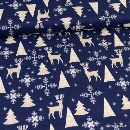 Tissu coton motifs rênes et sapins de Noël fond bleu