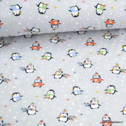 Tissu jersey motifs pingouins d'hiver fond gris - Oeko tex