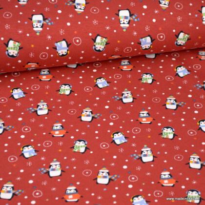 Tissu jersey motifs pingouins d'hiver fond rouge - Oeko tex