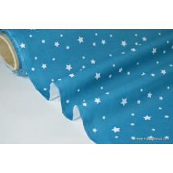 Tissu coton imprimé dessin étoiles multi pétrole .x1m