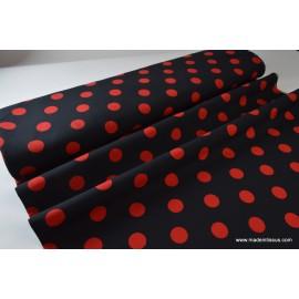 Tissu HIPPYE 100%pes fond noir pois rouge coloris16 150cm