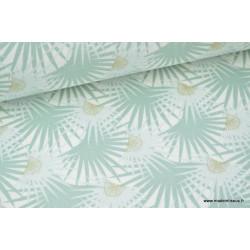 Tissu 100% coton feuilles de palmier sur fond menthe .x1m