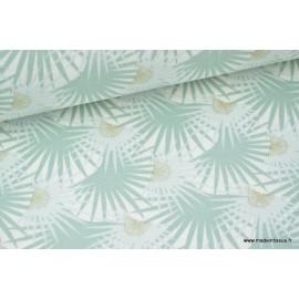 Tissu 100% coton feuilles de palmier sur fond menthe x50cm