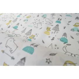 Tissu 100%coton imprimé chiens, sapins, étoiles  x50cm