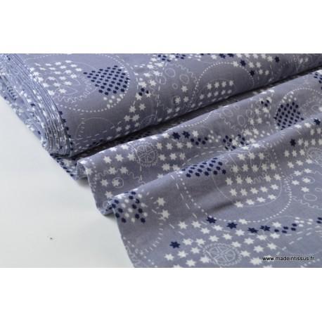 Double gaze coton imprimé Roulements et étoiles gris x50cm