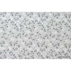 Tissu coton imprimé fleurs de magnolia gris .x1m