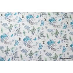 Tissu sergé coton imprimé papillons et libellules turquoise .x1m