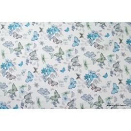 Tissu sergé coton imprimé papillons et libellules turquoise x50cm