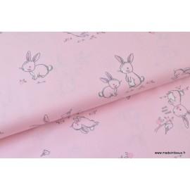 Popeline coton imprimé gros lapins roses .