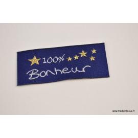 """Etiquette tissée à coudre message """"100% Bonheur"""" 20x45mm"""