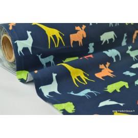 Tissu cretonne coton imprimé animaux géométriques fond bleu marine x1m