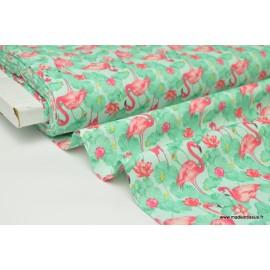Tissu cretonne coton imprimée Flamants roses fond vert x1m