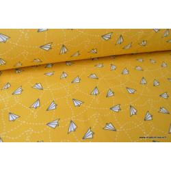 Tissu 100%coton imprimé Avions en papier fond Moutarde  x1m