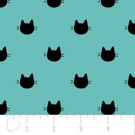 Popeline imprimée tête de chats noir sur fond menthe .x1m